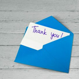 Blank card and envelope with thank you on background
